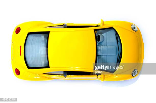 Yellow toy car from above
