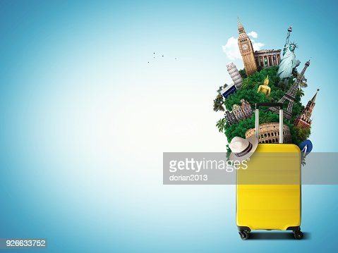 Yellow travel bag with world landmark : Stock Photo
