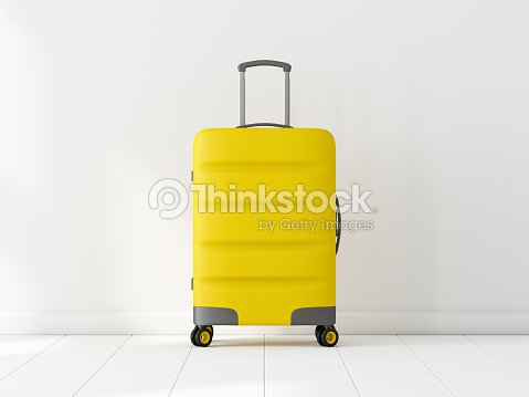 Yellow Travel cabin suitcase in white room : Stock Photo