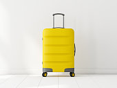 Yellow Travel cabin suitcase in white room, 3d rendering