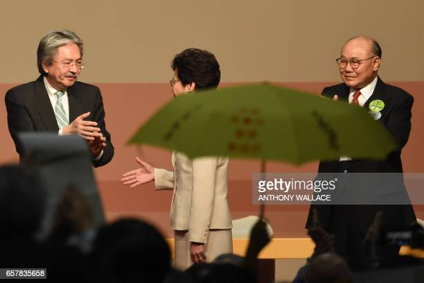 A yellow umbrella a symbol of Hong Kong's prodemocracy movement is seen raised in the crowd as Hong Kong's new chief executive Carrie Lam reaches out...