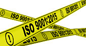 "Yellow warning tapes with inscription ""ISO 9001"