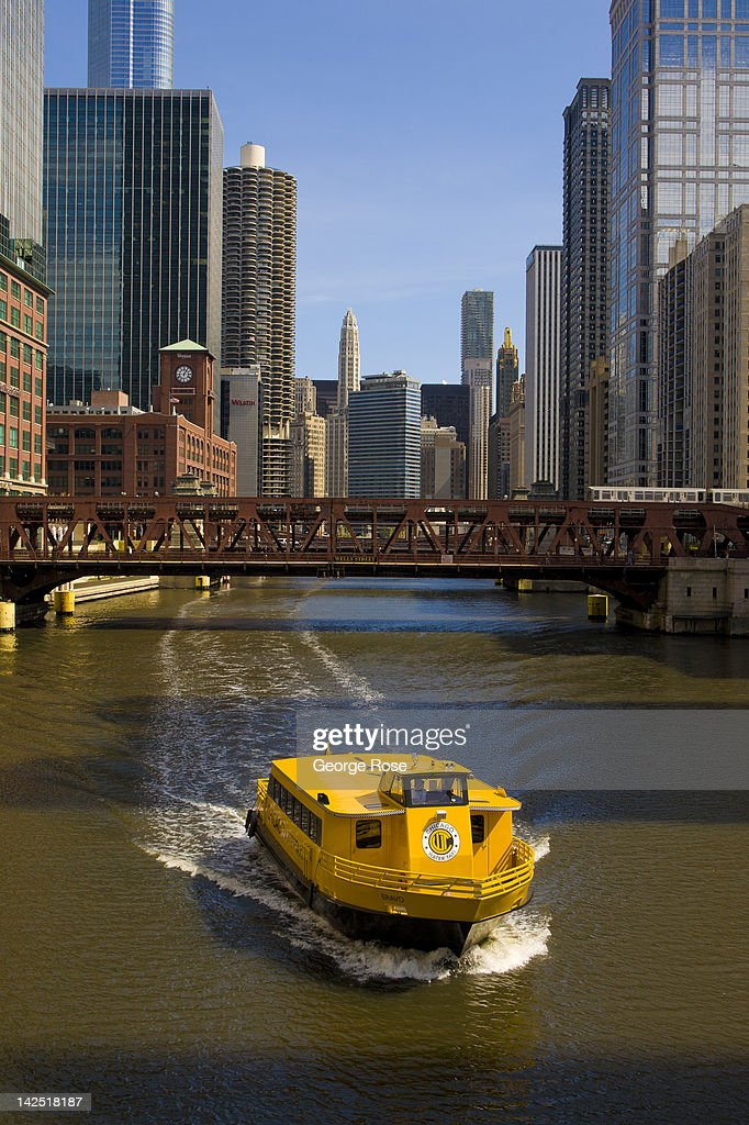 A yellow water taxi makes its way up the Chicago River on March 26, 2012 in Chicago, Illinois. Chicago's unusually moderate winter and spring weather has been a boost to the local tourism economy.