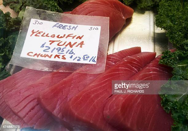 Yellowfin Tuna steaks are seen for sale at the Eastern Market February 25 in Washington DC AFP PHOTO/Paul J Richards