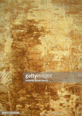 Yellowing, brownish wall.