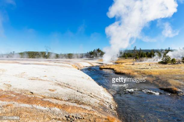 USA, Yellowstone National Park, Black Sand Basin, Iron Spring Creek with eruption of Cliff Geyser