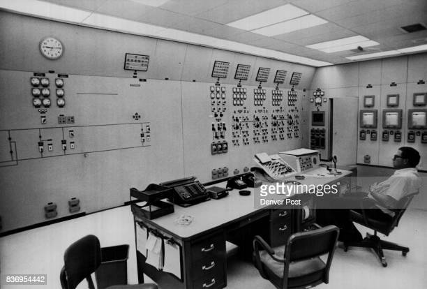 Yellowtail Dam Mark Harper of Fort Smith Mont sits at control desk in control room inside Yellowtail Dam and power plant This room links the 250000...