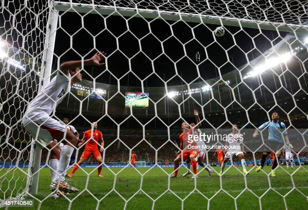 Yeltsin Tejeda of Costa Rica clears the ball off the line as goalkeeper Keylor Navas looks on during the 2014 FIFA World Cup Brazil Quarter Final...