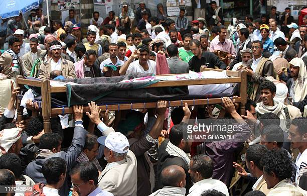 Yemeni antiregime mourners carry the bodies of fighters loyal to opposition tribal chief Sheikh Sadiq alAhmar who were killed in clashes with...