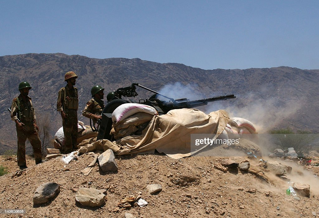 Yemeni army soldiers fire artillery at AlQaeda militants' positions near the southern town of Loder in Abiyan province on April 30 2012 where at...