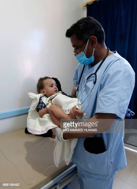 A Yemeni baby suspected of being infected with cholera receives treatment at a hospital in Sanaa on May 25 2017 Cholera has killed 315 people in...