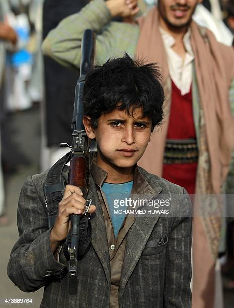 A Yemeni boy chews Qat a mild drug used daily by many Yemenis during a march in support of the Shiite Huthi movement and in protest to the Saudiled...