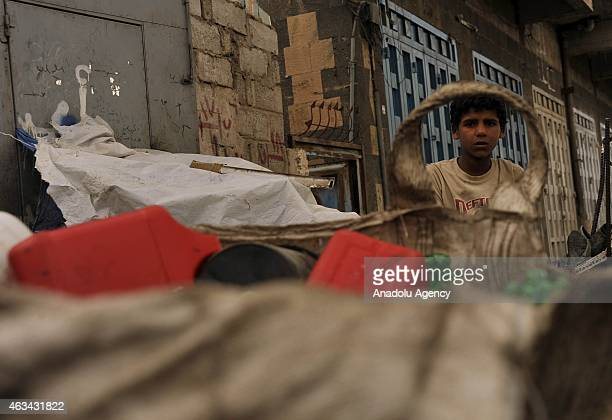 Yemeni boy collects garbages to recycle to earn money is seen inside dumps in Sanaa Yemen on February 14 2015 UNICEF had announced that 147 million...