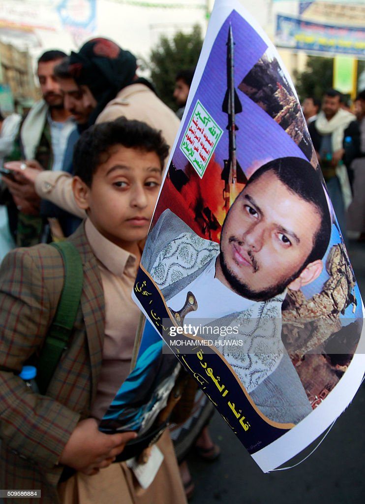A Yemeni boy holds a portrait of the Shiite Huthi rebels leader, Abdulmalik al-Huthi, during a rally commemorating the fifth anniversary of the 2011 Arab Spring uprising that toppled the then-president Ali Abdullah Saleh, on February 11, 2016 in the capital Sanaa. / AFP / MOHAMMED HUWAIS
