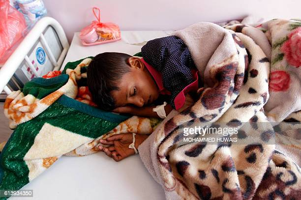 A Yemeni boy receives treatment at a hospital in the capital Sanaa on October 11 2016 The World Heath Organization said it had confirmed 11 cases of...