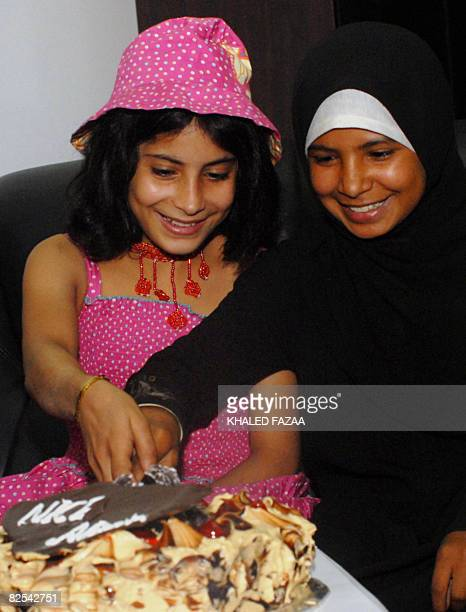 Yemeni child brides eight yearold Nojud Ali and nine yearold Arwa cut a cake as they celebrate their divorces granted them by a Yemeni court with a...