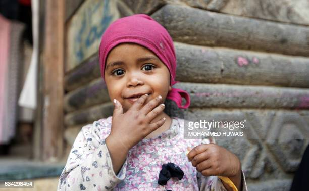 A Yemeni child poses for a picture in Sanaa's old city on January 24 2017 The devastating conflict that escalated in March 2015 with a military...