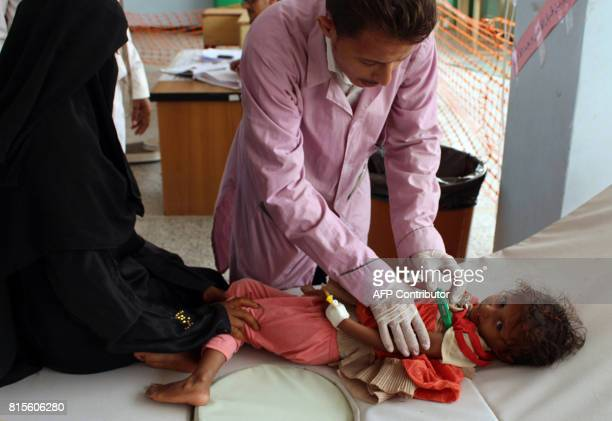 A Yemeni child suspected of being infected with cholera is checked by a doctor at a makeshift hospital operated by Doctors Without Borders in the...