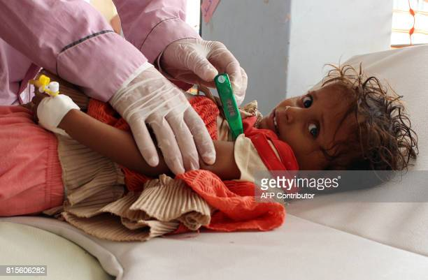 Yemeni child suspected of being infected with cholera is checked by a doctor at a makeshift hospital operated by Doctors Without Borders in the...