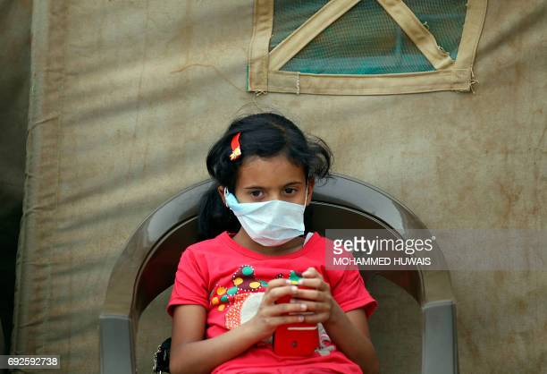 A Yemeni child suspected of being infected with cholera sits outside a makeshift hospital in Sanaa on June 5 2017 Yemen is descending into total...
