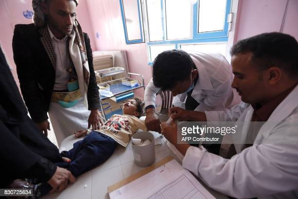 A Yemeni child who is suspected of being infected with cholera receives treatment at a hospital in the capital Sanaa on August 12 2017 A cholera...