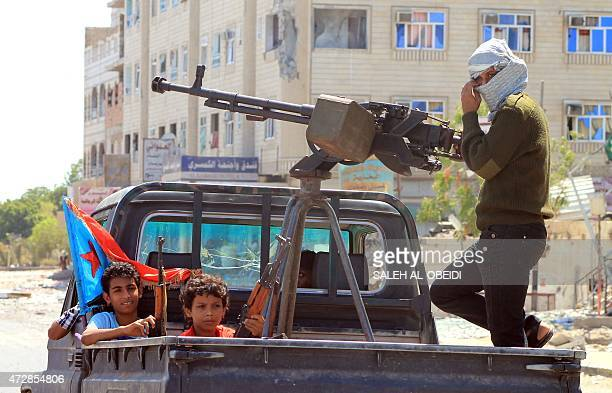 Yemeni children holding rifles sit in the back of a heavily armed pick up truck with fighters loyal to Yemen's Saudibacked President Abedrabbo...