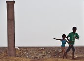Yemeni children play on April 13 2015 at a refugee boarding facility run by the UN High Commission for Refugees at Obock a small port town in...