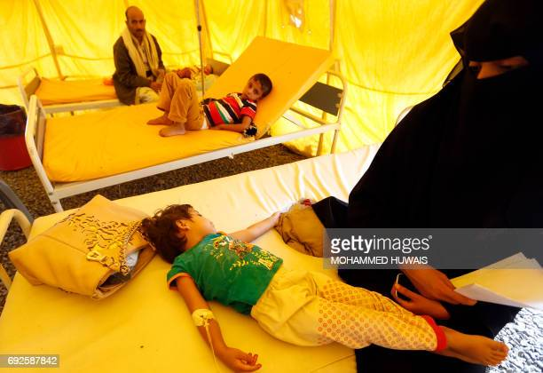 Yemeni children suspected of being infected with cholera receive treatment at a makeshift hospital in Sanaa on June 5 2017 Yemen is descending into...