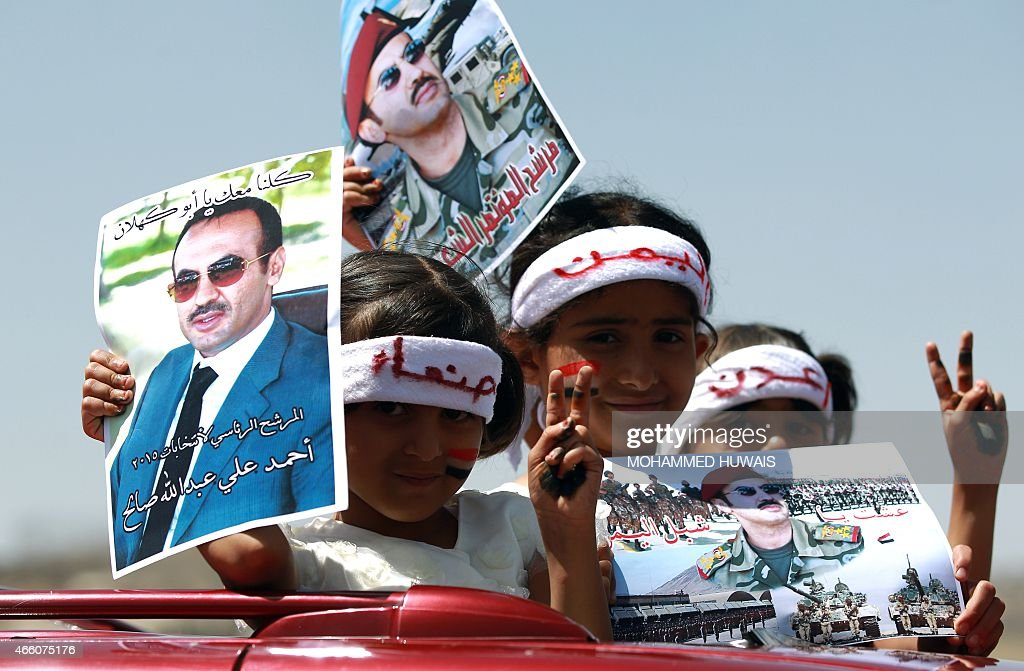 Yemeni children take part in a demonstration outside the house of Ahmed <a gi-track='captionPersonalityLinkClicked' href=/galleries/search?phrase=Ali+Abdullah+Saleh&family=editorial&specificpeople=221711 ng-click='$event.stopPropagation()'>Ali Abdullah Saleh</a> (portrait), the son of Yemen's former president <a gi-track='captionPersonalityLinkClicked' href=/galleries/search?phrase=Ali+Abdullah+Saleh&family=editorial&specificpeople=221711 ng-click='$event.stopPropagation()'>Ali Abdullah Saleh</a> who stepped down in early 2012, calling for presidential elections and demanding the son of the ex-strongman to run as a candidate, on March 13, 2015 in Sanaa. AFP PHOTO / MOHAMMED HUWAIS