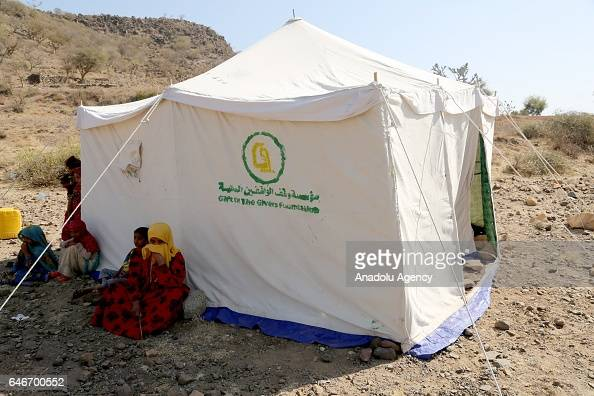 Yemeni civilians are seen near a tent they built up near the Mocha port on the Red Sea in Taiz Yemen on March 1 2017 Escalating clashes cause...