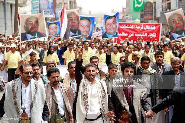 Yemeni demonstrators shout slogans as they march from Sana'a University to the Ministry of Oil and Minerals during a protest against power cuts and...