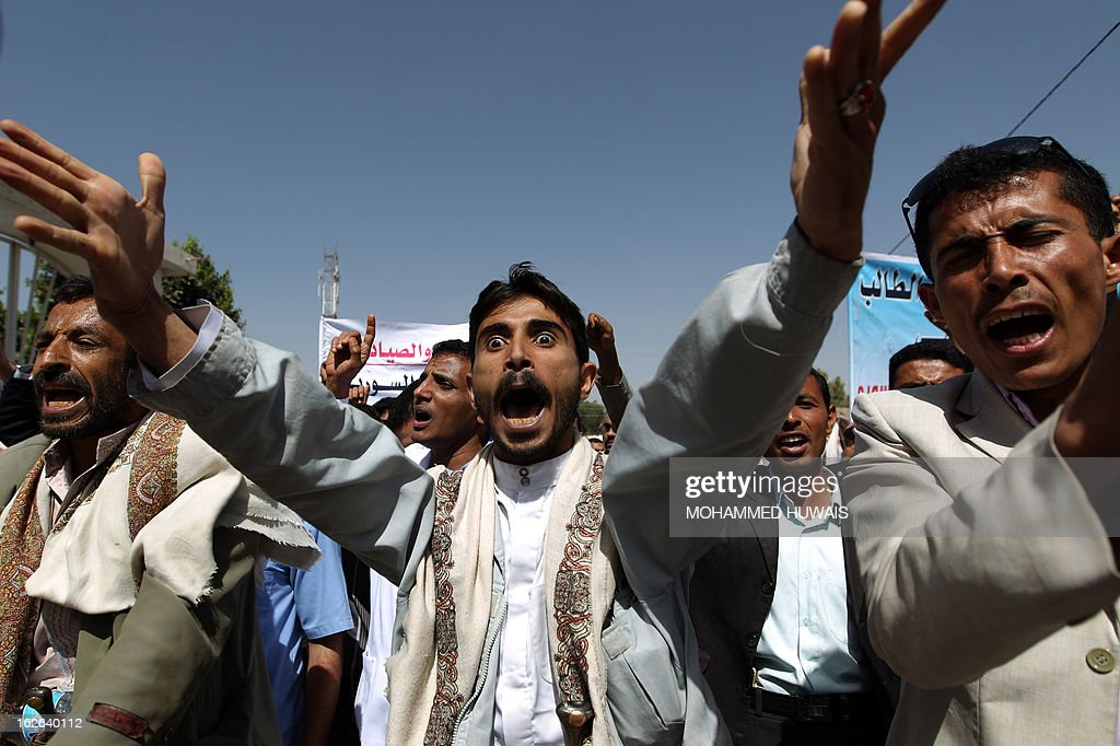 Yemeni demonstrators shout slogans to demand the release of a Yemeni medical student, who was arrested in Syria last year, during a protest outside the Syrian embassy in Sanaa on February 25, 2013. According to local media sources the student was sentenced to death on February 24.