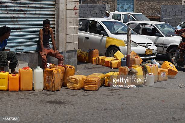 Yemeni drivers wait in line to refuel their vehicles at a gas station during ongoing fuel shortage in Aden city of Yemen on April 2 2015 Yemen is...
