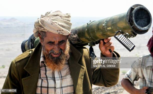 A Yemeni fighter loyal to the Saudibacked Yemeni president holds a rocket launcher on his shoulder at a position which was taken from ShiiteHuthi...