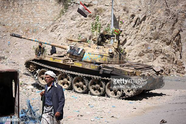 A Yemeni fighter loyal to Yemen's exiled President Abedrabbo Mansour Hadi monitors a road during clashes with Shiite Huthi rebels west of the city of...
