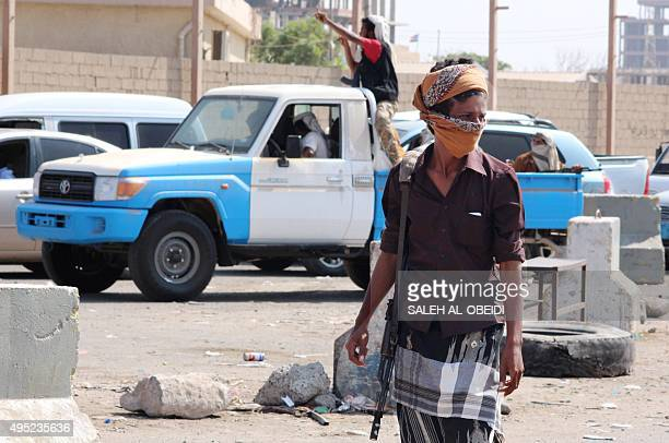 Yemeni fighters of the Popular Resistance Committees supporting forces loyal to Yemen's Saudibacked President Abedrabbo Mansour Hadi patrol a street...