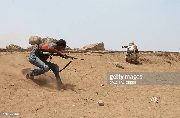 Yemeni fighters of the southern separatist movement loyal to exiled President Abedrabbo Mansour Hadi keep watch during their battle against Shiite...