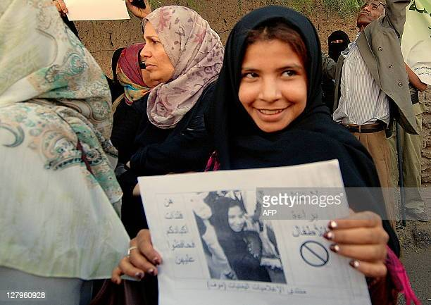 Yemeni former childbride Nujud Mohammed Ali participates in a demonstration to support proposed legislation banning the marriage of girls under 17...
