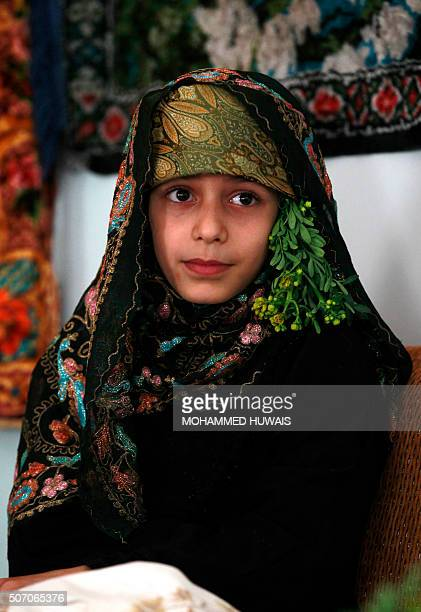 A Yemeni girl dressed in a traditional costume attends an antiwar gallery protest against Saudiled military operations in her country on January 27...