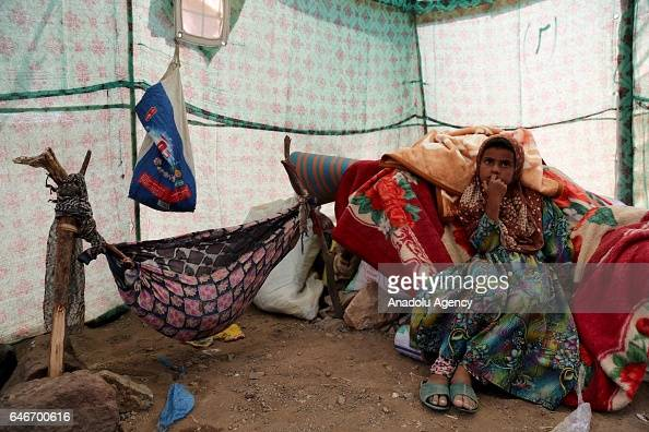 Yemeni girl is seen inside of a tent near the Mocha port on the Red Sea in Taiz Yemen on March 1 2017 Escalating clashes cause internal migration of...