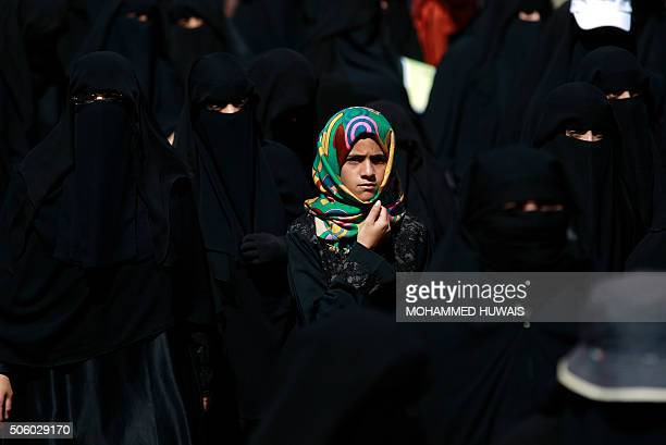 Yemeni girl looks on during a protest by women in front of United Nations office in the Yemeni capital Sanaa on January 21 against the ongoing...