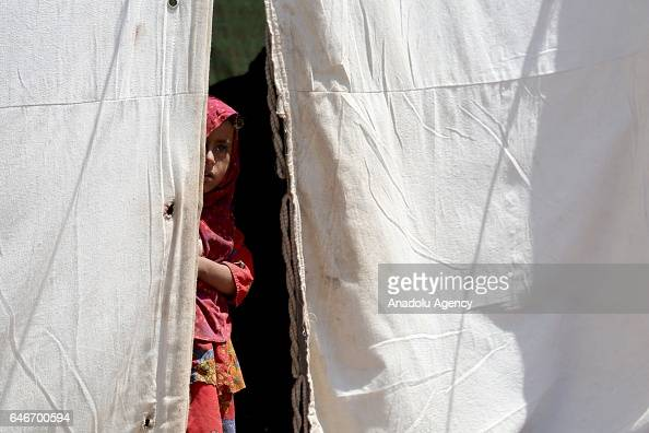 Yemeni girl looks out of a tent near the Mocha port on the Red Sea in Taiz Yemen on March 1 2017 Escalating clashes cause internal migration of...
