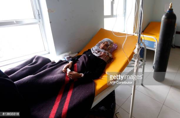 A Yemeni girl suspected of being infected with cholera receive treatment at a makeshift hospital in Sanaa on July 13 2017 More than 320000 suspected...