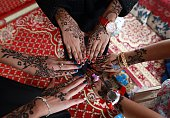 Yemeni girls show their hands decorated with traditional henna designs in the Yemeni capital Sanaa on July 29 2014 as they celebrate Eid alFitr which...