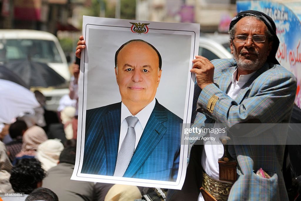 A Yemeni holds portrait of <a gi-track='captionPersonalityLinkClicked' href=/galleries/search?phrase=Abd+Rabbuh+Mansur+Hadi&family=editorial&specificpeople=9836032 ng-click='$event.stopPropagation()'>Abd Rabbuh Mansur Hadi</a> at Change Square during a friday protest in solidarity with <a gi-track='captionPersonalityLinkClicked' href=/galleries/search?phrase=Abd+Rabbuh+Mansur+Hadi&family=editorial&specificpeople=9836032 ng-click='$event.stopPropagation()'>Abd Rabbuh Mansur Hadi</a>, forced to resign from presidency by Shiite Houthi movement, in Ibb, Yemen on February 27, 2015.