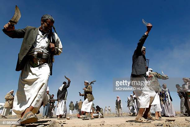 TOPSHOT Yemeni Huthi rebels take part in a gathering to mobilise more fighters into several battlefronts on November 1 2016 on the outskirts of the...