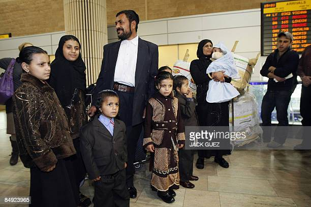 Yemeni Jew Said Ben Yisrael stands with members of his family after arriving to Israel at Tel Aviv's Ben Gurion airport on February 19 after leaving...