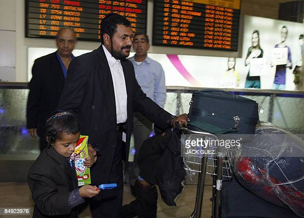 Yemeni Jew Said Ben Yisrael walks with a young relative after arriving to Israel at Tel Aviv's Ben Gurion airport on February 19 after leaving Yemen...