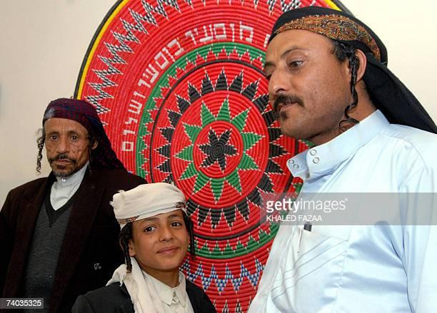 Yemeni Jew Said Said Yahia Annaati stands at his home with his son Barukh and his maternal uncle Yaish Salamon alNehari in Raydah 70 kms north of...