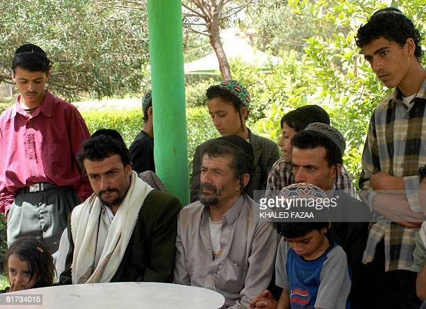 Yemeni Jew Salem Mussa Marhabi poses for a picture with male family members at their temporary residence in the tourist city hotel compound in Sanaa...
